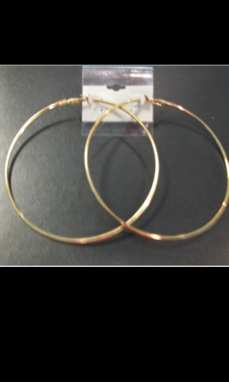 Large gold hoop earrings 1970s style 1980s style