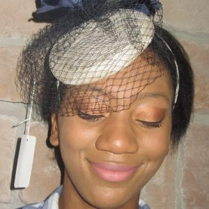 cream fascinator hats
