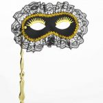 Mardi Gras masqerade mask on stick