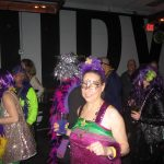 Mardi Gras fun dancing at the masquerade ball